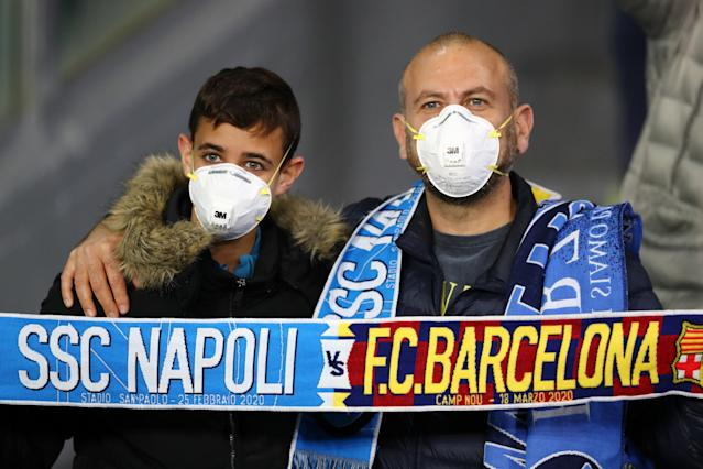 Some fans at Tuesday's Napoli-Barcelona Champions League clash in Italy wore masks to protect against the coronavirus. (Photo by Michael Steele/Getty Images)