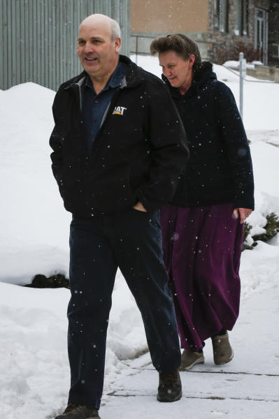 "FILE - This Feb. 3, 2017, file photo, Gail Blackmore, right, and James Oler arrive at the courthouse in Cranbrook, British Columbia. Two former bishops of an isolated religious commune in British Columbia were convicted Monday, July 24, of practicing polygamy after a decades-long legal fight launched by the provincial government. The court found James Oler married five women in so-called ""celestial"" marriages involving residents in the tiny religious community of Bountiful. (Jeff McIntosh/The Canadian Press via AP, File)"