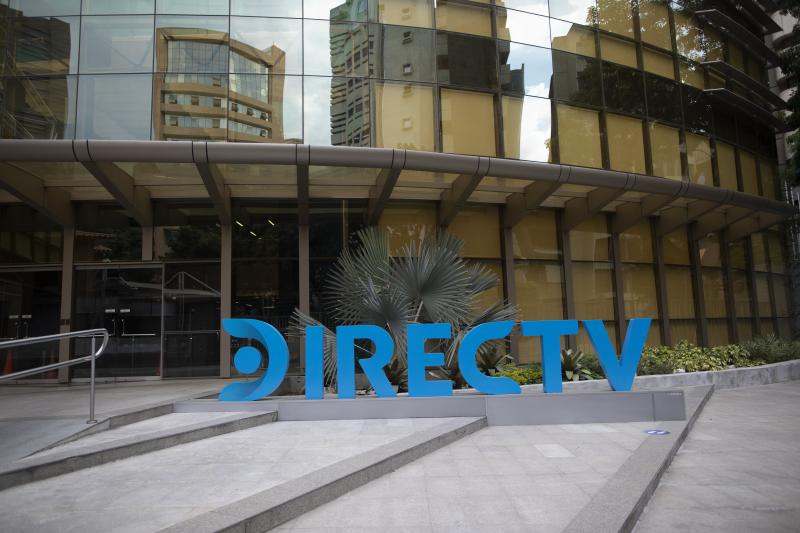 A DirectTV logo identifies the company's headquarters in Caracas, Venezuela, Friday, May 22, 2020. Venezuela's high court ordered on Friday the immediate seizure of all DirecTV property, days after the U.S. firm abandoned its services in the South American nation, citing U.S. sanctions. (AP Photo/Ariana Cubillos)