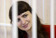 Belarusian journalist Katsiaryna Barysevich smiles as she attends a court hearing in Minsk, Belarus, Friday, Feb. 19, 2021. Barysevich is accused of revealing personal data in her report on the death of a protester, part of the Belarusian authorities to stifle independent media reports about protests against authoritarian President Alexander Lukashenko. (Ramil Nasibulin/BelTA pool photo via AP)