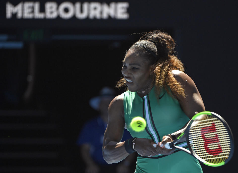 United States' Serena Williams makes a backhand return to Ukraine's Dayana Yastremska during their third round match at the Australian Open tennis championships in Melbourne, Australia, Saturday, Jan. 19, 2019. (AP Photo/Andy Brownbill)