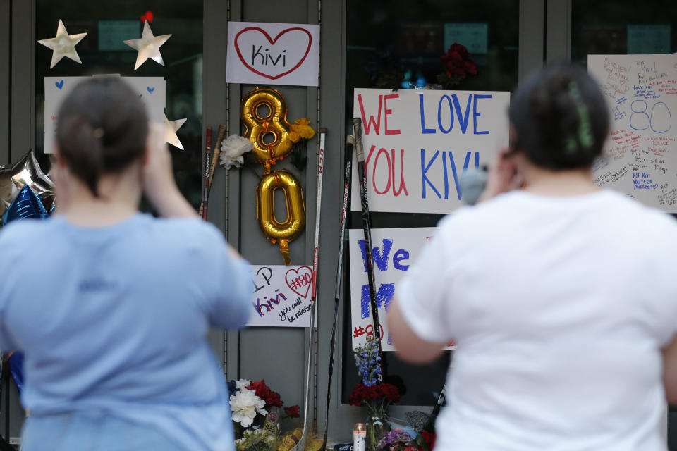 Columbus Blue Jackets fans visit a makeshift memorial in front of Nationwide Arena Monday, July 5, 2021, in Columbus, Ohio, to remember Blue Jackets goaltender Matiss Kivlenieks who died of chest trauma from an errant fireworks mortar blast in what authorities described Monday as a tragic accident on the Fourth of July. (AP Photo/Jay LaPrete)