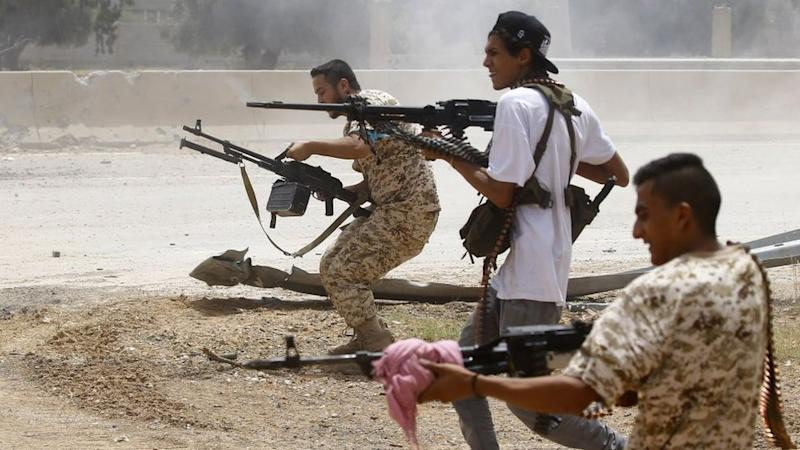 Fighters loyal to the internationally-recognised Government of National Accord (GNA) open fire from their position in the al-Sawani area south of the Libyan capital Tripoli during clashes with forces loyal to strongman Khalifa Haftar