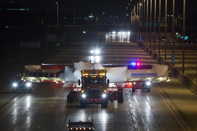 The electromagnet moves down Interstate 88 in Naperville, Ill., Friday, July 26, 2013 on its way to Fermilab. The electromagnet is 50 feet wide, weighs more than 15 tons and has taken a month to transport 3,200 miles from New York to Illinois. (AP Photo/Scott Eisen)