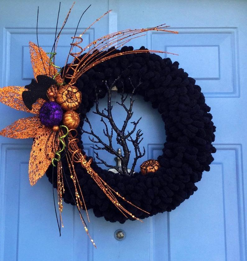 """<p>This <a href=""""https://www.popsugar.com/buy/Halloween-Wreath-477394?p_name=Halloween%20Wreath&retailer=etsy.com&pid=477394&price=53&evar1=casa%3Aus&evar9=42249705&list1=shopping%2Challoween%2Cwreaths%2Challoween%20decor&prop13=api&pdata=1"""" rel=""""nofollow"""" data-shoppable-link=""""1"""" target=""""_blank"""" class=""""ga-track"""" data-ga-category=""""Related"""" data-ga-label=""""https://www.etsy.com/listing/721620079/halloween-wreath-halloween-wreath-for?ga_order=most_relevant&amp;ga_search_type=all&amp;ga_view_type=gallery&amp;ga_search_query=halloween+wreath&amp;ref=sr_gallery-2-21&amp;frs=1"""" data-ga-action=""""In-Line Links"""">Halloween Wreath</a> ($53) has the perfect balance of creepy and cute.</p>"""