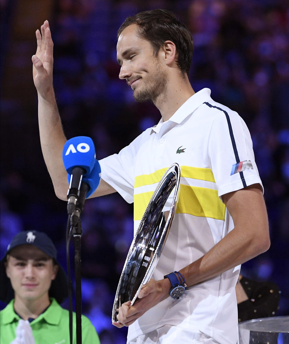 Russia's Daniil Medvedev waves after receiving his trophy for runner-up after losing to Serbia's Novak Djokovic in the men's singles final at the Australian Open tennis championship in Melbourne, Australia, Sunday, Feb. 21, 2021.(AP Photo/Andy Brownbill)