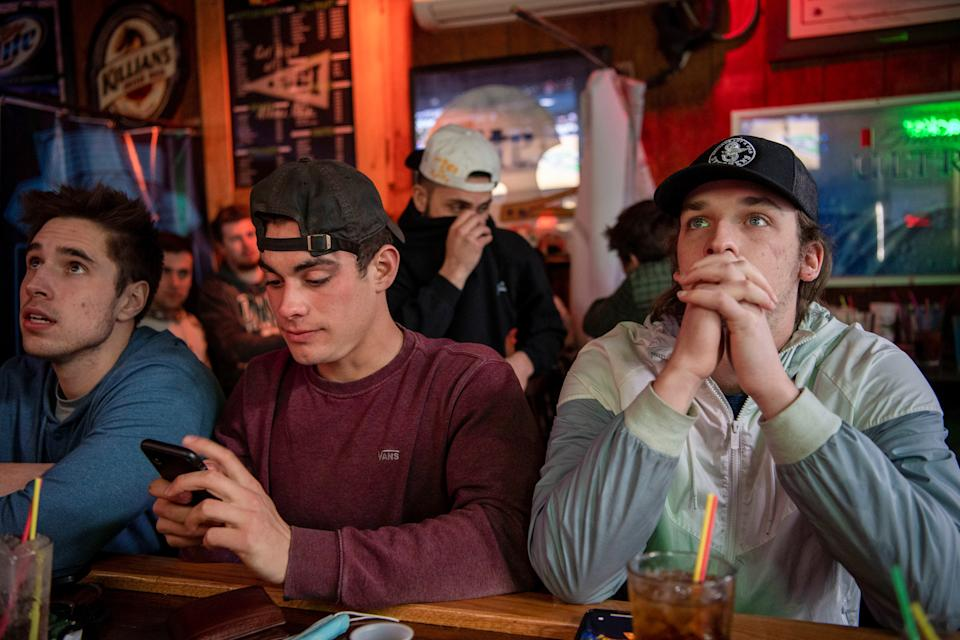 Ohio University fans pack bars to watch their team compete in the 2021 NCAA Tournament as coronavirus disease (COVID-19) restrictions are eased in Athens, Ohio, U.S., March 20, 2021.  REUTERS/Gaelen Morse
