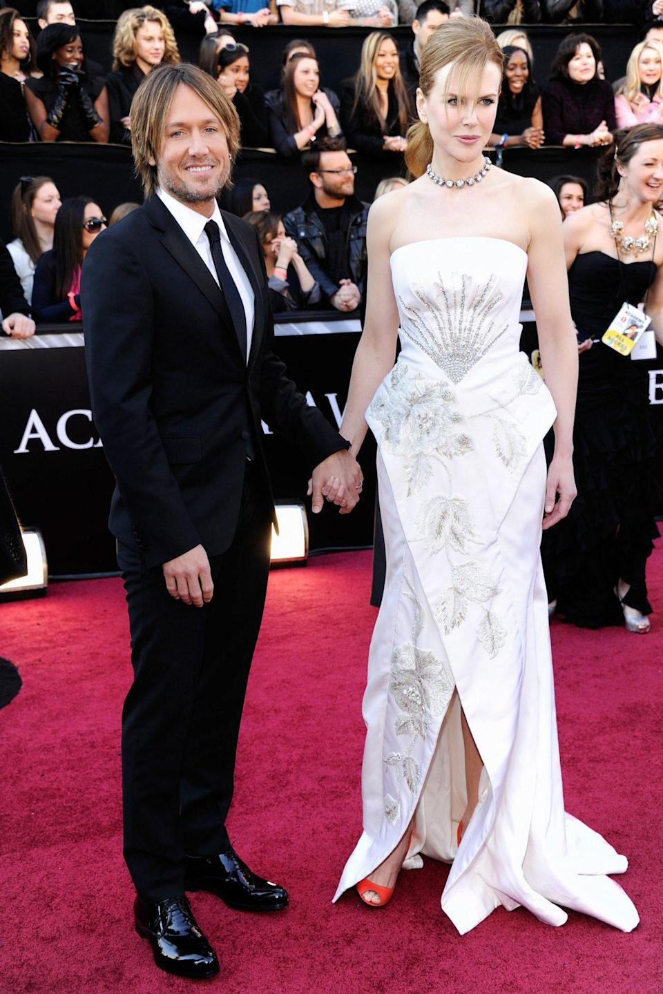 <p>Nicole Kidman brought her husband Keith Urban along as her date, and wore a beaded Dior gown for the occasion. She was nominated for Best Actress for <em>Rabbit Hole</em>. </p>