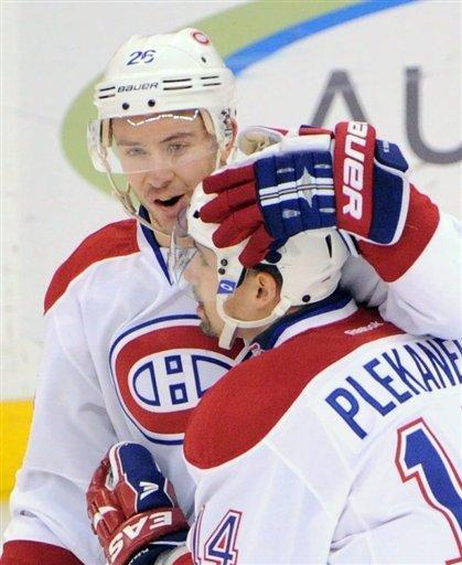 Montreal Canadiens' Tomas Plekanec is congratulated on his first-period goal by teammate Josh Gorges during an NHL hockey game against the Ottawa Senators in Ottawa, Ontario, on Friday, March 16, 2011. (AP Photo/The Canadian Press, Sean Kilpatrick)