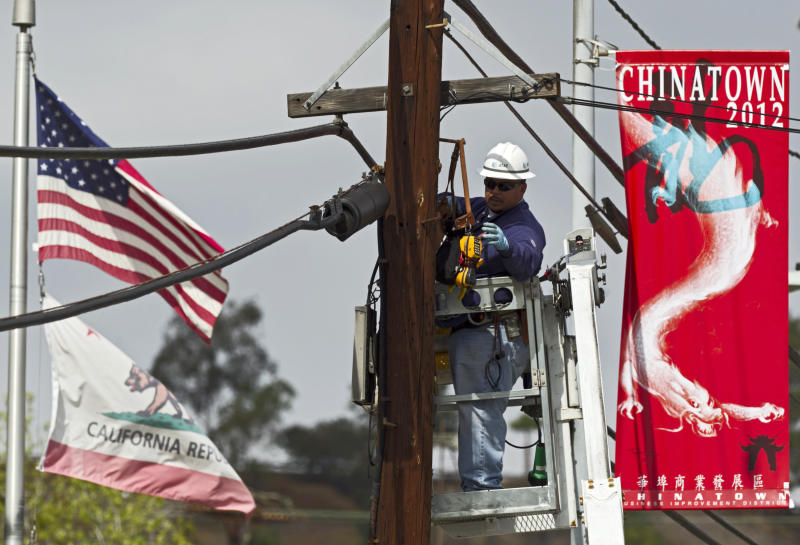 In this March 6, 2012 photo, an AT&T technician works on fiber optic cables used for the expansion of AT&T U-verse Internet service in the Chinatown neighborhood in Los Angeles. U.S. employers added 227,000 jobs in February to complete three of the best months of hiring since the recession began. The unemployment rate was unchanged, largely because more people streamed into the work force. The Labor Department said Friday, March 9, 2012, that the unemployment rate stayed at 8.3 percent last month, the lowest in three years. (AP Photo/Damian Dovarganes)
