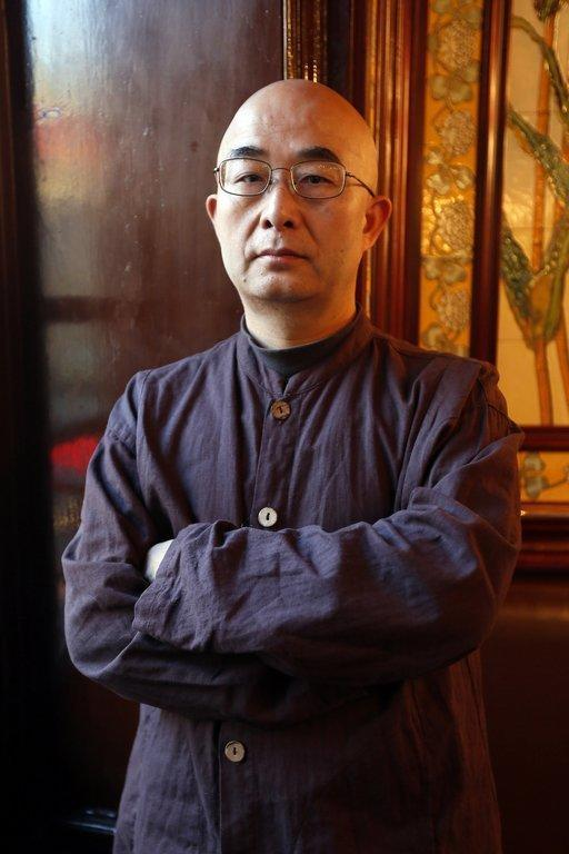 Chinese dissident writer Liao Yiwu at a promotion in Paris on January 16, 2013 for his book. He says he has little hope that human rights in China will improve under Xi Jinping, who was appointed new head of the Communist Party in the autumn and is expected to be anointed President later this year