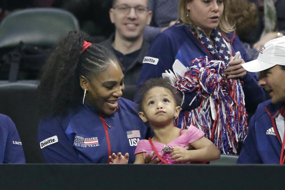 United States' Serena Williams sits with her daughter, Alexis Olympia Ohanian Jr., as they look on during a Fed Cup qualifying tennis match Saturday, Feb. 8, 2020, in Everett, Wash. (AP Photo/Elaine Thompson)