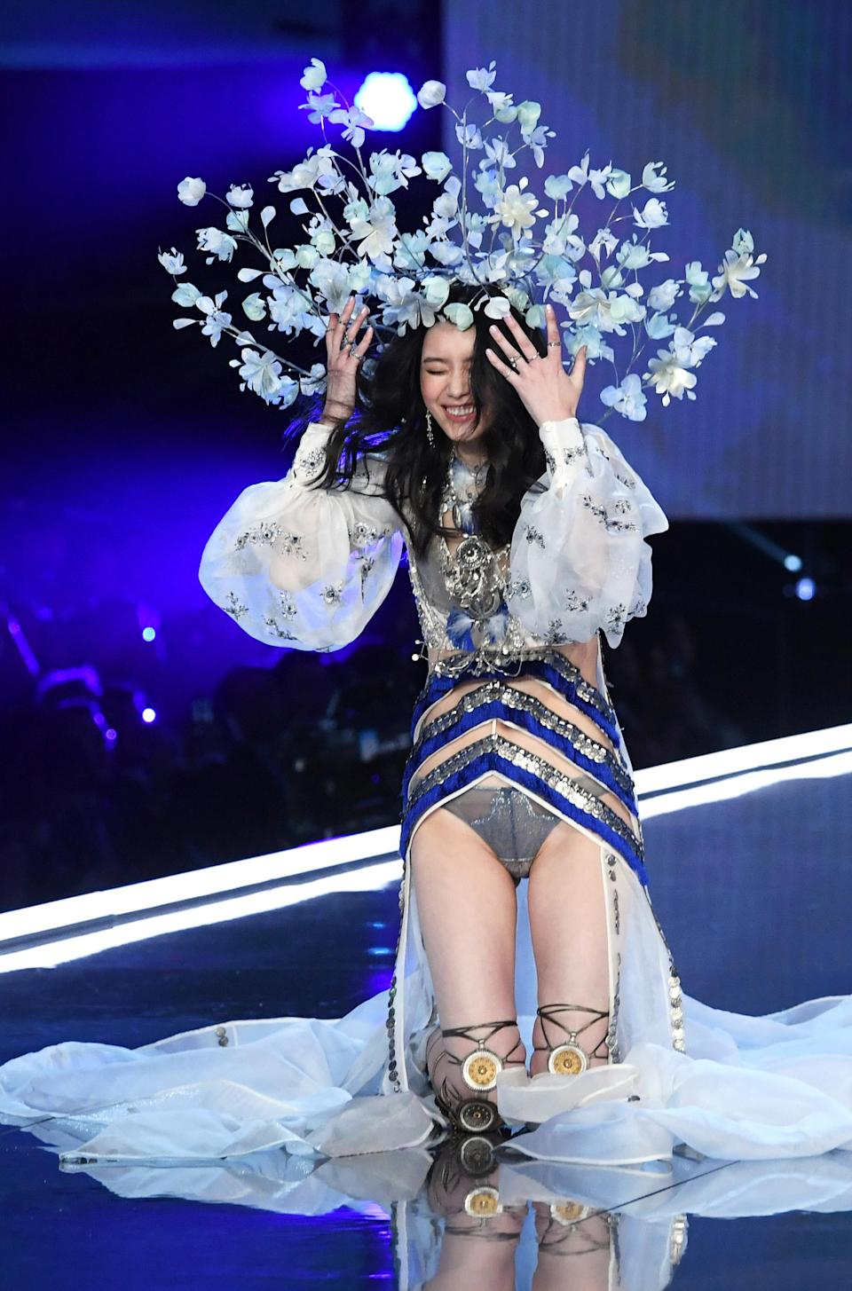 <p>With such difficult headpieces to wear (not to mention sky-high heels), a tumble was always likely and this year it was Chinese model Ming Xi who stumbled. <em>[Photo: Rex]</em> </p>