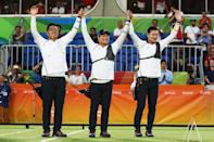 <p>(L-R) Woojin Kim, Seungyun Lee and Bonchan Ku of Korea celebrate defeating the United States during the Men's Team Final match on Day 1 of the Rio 2016 Olympic Games at the Sambodromo on August 6, 2016 in Rio de Janeiro, Brazil. (Photo by Paul Gilham/Getty Images) </p>