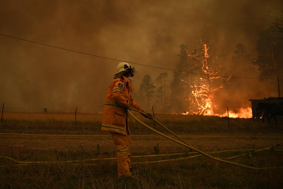 NSW Rural Fire Service crews fight the Gospers Mountain Fire as it impacts a property at Bilpin.
