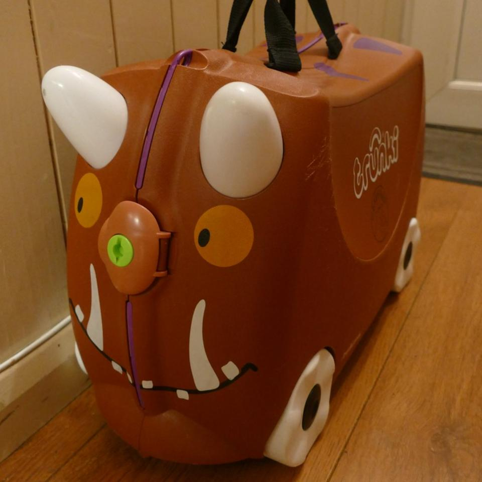 Andrew's suitcase is packed for his night away from home.