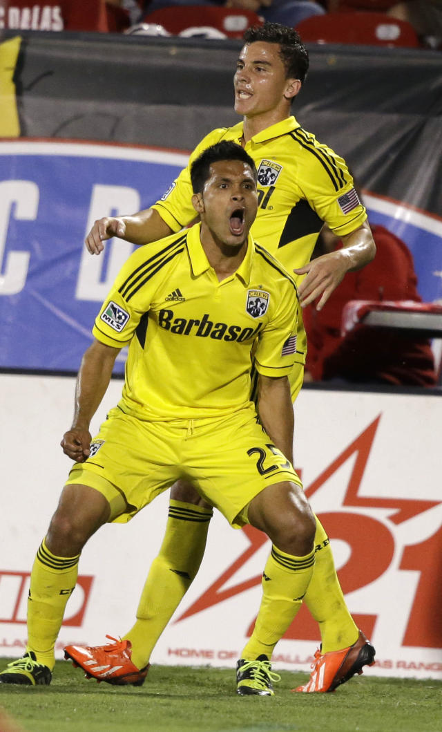 Columbus Crew forward Jairo Arrieta (25) celebrates scoring a goal, in front of Bernardo Anor during the first half of an MLS soccer game against FC Dallas on Sunday, Sept. 29, 2013, in Frisco, Texas. (AP Photo/LM Otero)
