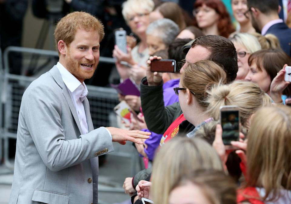 Britain's Prince Harry (L) meets people during a walkabout at the Cathedral quarter in the centre of Belfast on September 7, 2017 on his first visit to Northern Ireland.  Prince Harry arrived in Northern Ireland for visits to Ballymena, Belfast and Hillsborough Castle during this, his first visit to the Province.  / AFP PHOTO / Paul FAITH        (Photo credit should read PAUL FAITH/AFP via Getty Images)