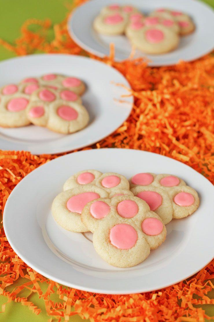 """<p>These cookies are paw-sitively adorable, not to mention simple to make. Call in the kids! </p><p><em><a href=""""https://thebearfootbaker.com/2015/04/bunny-paw-thumbprint-cookies/"""" rel=""""nofollow noopener"""" target=""""_blank"""" data-ylk=""""slk:Get the recipe from The Bear Foot Baker »"""" class=""""link rapid-noclick-resp"""">Get the recipe from The Bear Foot Baker »</a></em></p><p><strong>RELATED: </strong><a href=""""https://www.goodhousekeeping.com/holidays/easter-ideas/g1027/10-easter-baskets-and-fillers/"""" rel=""""nofollow noopener"""" target=""""_blank"""" data-ylk=""""slk:30 Creative Easter Gift for Kids That Are Seriously Adorable"""" class=""""link rapid-noclick-resp"""">30 Creative Easter Gift for Kids That Are Seriously Adorable</a></p>"""