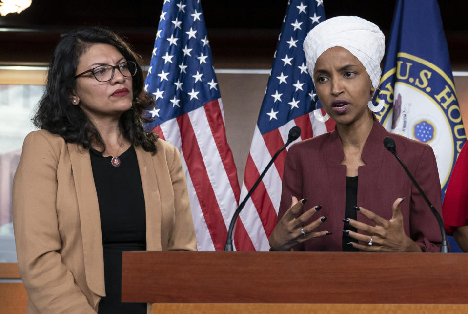 """FILE - In this July 15, 2019, file photo, U.S. Rep. Ilhan Omar, D-Minn, right, speaks, as U.S. Rep. Rashida Tlaib, D-Mich. listens, during a news conference at the Capitol in Washington. The U.S. envoy to Israel said he supports Israel's decision to deny entry to two Muslim congresswomen ahead of their planned visit to Jerusalem and the West Bank. Ambassador David Friedman said Thursday, Aug. 15, 2019, in a statement following the Israeli government's announcement that Israel """"has every right to protect its borders"""" against promoters of boycotts """"in the same manner as it would bar entrants with more conventional weapons."""" (AP Photo/J. Scott Applewhite, File)"""