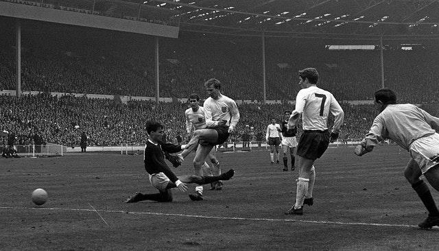 A struggling Jack Charlton nets for the hosts