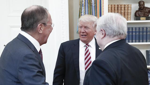 Russian Foreign Minister Sergey Lavrov, U.S. President Donald Trump and Russian Ambassador Sergey Kislyak meet in the Oval Office at the White House on May 10, 2017.