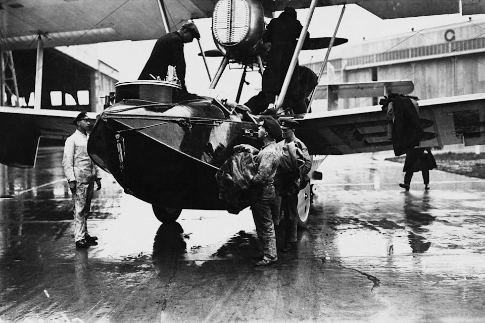 RAF Squadron Leader Archibald Stuart-MacLaren in the cockpit (top, left) of his Vickers Vulture amphibious biplane at Calshot aerodrome, Hampshire, 25th March 1924. Stuart-MacLaren, along with Flying Officer William Plenderleith and Sergeant W. H. Andrews are about to attempt a round-the-world flight. The airmen made it as far as the Bering Sea, where they were forced to ditch on 4th August 1924. (Photo by Brooke/Topical Press Agency/Hulton Archive/Getty Images)
