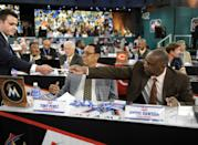 Miami Marlins representatives Tony Perez, left, and Andre Dawson hand over their pick during the 2014 MLB baseball draft Thursday, June 5, 2014, in Secaucus, N.J. The Marlins chose Tyler Kolek with the second pick in the draft. (AP Photo/Bill Kostroun)