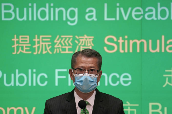 Hong Kong Finance Minister Paul Chan attends a press conference on budget for 2021-22 in Hong Kong, Wednesday, Feb, 24, 2021. Hong Kong will introduce 120 billion Hong Kong dollars ($15.4 billion) in fiscal measures to help businesses and residents impacted by the coronavirus pandemic, as it looks towards economic growth later this year following a recession in 2020. (AP Photo/Kin Cheung)