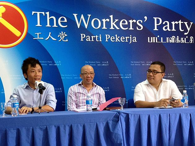 Litigation lawyer Terence Tan (centre) and civil activist Nizam Ismail (right) speak at a Workers' Party youth forum on race issues. (Yahoo! photo)