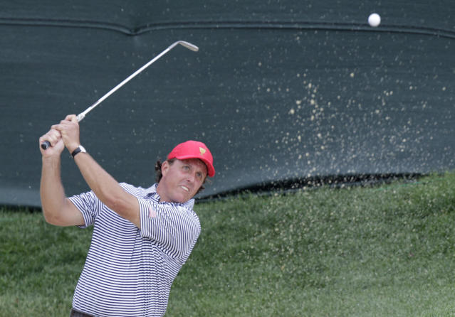 United States' Phil Mickelson hits from the sand on the first hole during a foursome match against the International team at the Presidents Cup golf tournament at Muirfield Village Golf Club Friday, Oct. 4, 2013, in Dublin, Ohio. (AP Photo/Jay LaPrete)
