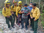 In this undated photo provided by the Association of Forest Communities of Petén on June 2020, Alvaro Ba operates a drone within the BioItza reserve in northern Guatemala to assess the characteristics of a forest fire. Alvaro is an associate of one of the community organizations that forms ACOFOP, which works to protect forests within Guatemala's Maya Biosphere. In 2020, the region has experienced a worrisome uptick in fires set illegally to clear land, while government resources to control flames have been diverted to manage the COVID-19 pandemic. (Aderito Chayax/ACOFOP via AP)