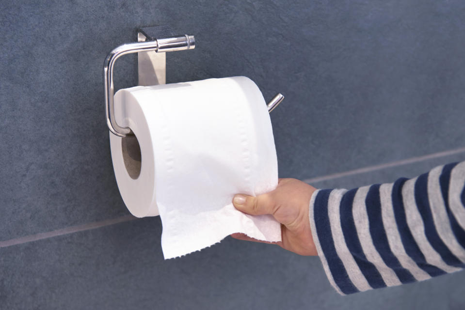 Child pulling toilet roll