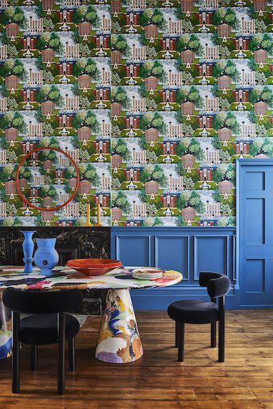 """<p>This contemporary conversational (meaning it depicts a scene) wallpaper of three Royal Historic Palaces – Hampton Court, Tower of London and Kensington Palace – has an illustrative, children's book feel. Therefore a childlike approach to shape and pattern is the perfect companion – chunky tableware in primary hues tempered with charcoal grey chairs and walnut floors ground the scheme. £165 per 10 metre roll, <a href=""""https://www.cole-and-son.com/en/products/palace-tales?v=3966"""" rel=""""nofollow noopener"""" target=""""_blank"""" data-ylk=""""slk:cole-and-son.com"""" class=""""link rapid-noclick-resp"""">cole-and-son.com</a></p>"""
