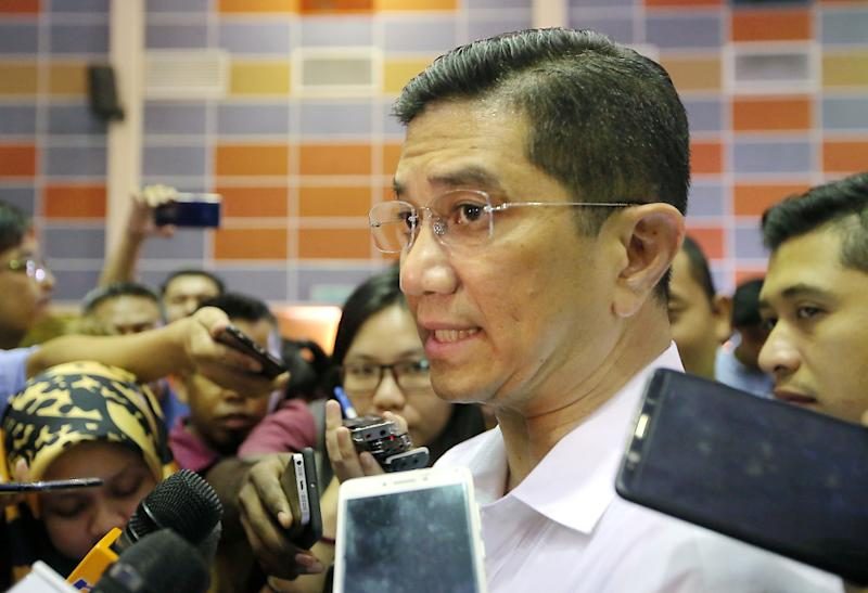 Economic Affairs Minister Datuk Seri Azmin Ali speaks to the press after visiting Felcra residents at the Dewan Besar Seberang Perak, Kampung Gajah July 22, 2019. — Picture by Farhan Najib