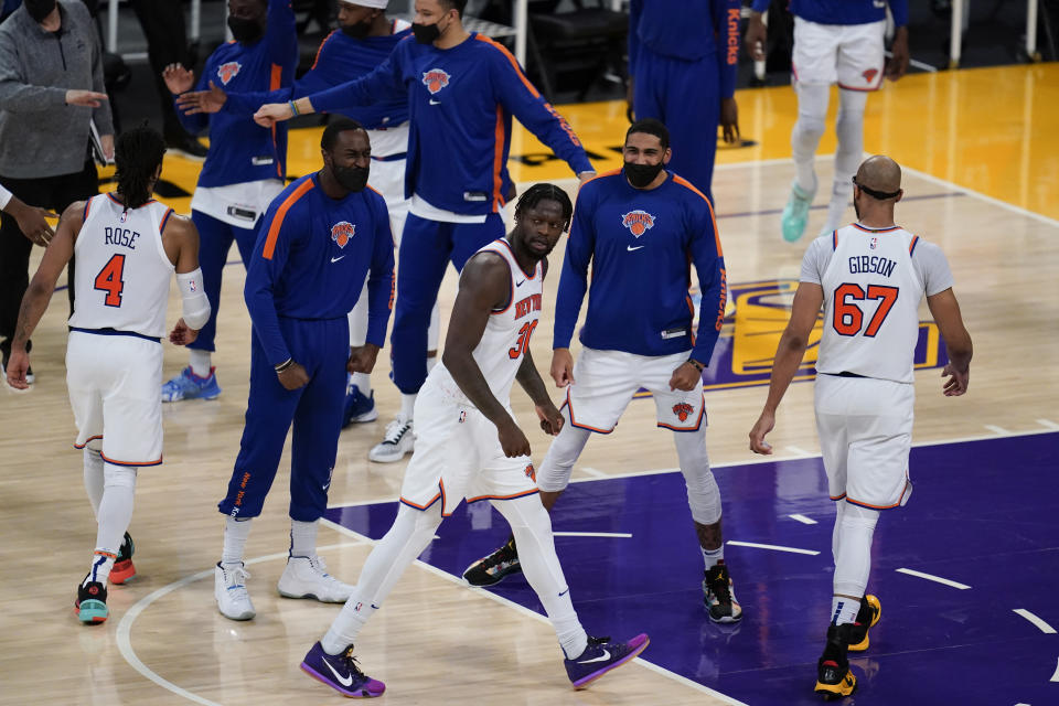 New York Knicks forward Julius Randle (30) celebrates with teammates after scoring during the fourth quarter of an NBA basketball game against the Los Angeles Lakers Tuesday, May 11, 2021, in Los Angeles. The Lakers won 101-99 in overtime. (AP Photo/Ashley Landis)