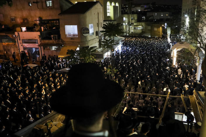 Ultra-Orthodox Jewish men attend the funeral of Yossi Kohn, 21, from Cleveland, Ohio, who died during Lag BaOmer celebrations at Mt. Meron in northern Israel, in Jerusalem, Sunday, May 2, 2021. A stampede at a religious festival attended by tens of thousands of ultra-Orthodox Jews in northern Israel killed dozens of people and injured about 150 early Friday, medical officials said. It was one of the country's deadliest civilian disasters. (AP Photo/Oren Ben Hakoon)