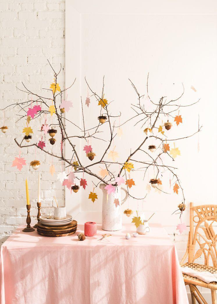 "<p>This beautiful seasonal display doubles as a party favor holder, with DIY acorn ornaments that are actually <a href=""https://www.amazon.com/Evolution-Hydration-Collection-Hibiscus-Wildberry/dp/B07KF31TJC/ref=sr_1_3?dchild=1&keywords=eos+lip+balm+pack&qid=1597081642&sr=8-3&tag=syn-yahoo-20&ascsubtag=%5Bartid%7C10055.g.33525114%5Bsrc%7Cyahoo-us"" rel=""nofollow noopener"" target=""_blank"" data-ylk=""slk:eos lip balms"" class=""link rapid-noclick-resp"">eos lip balms</a> in disguise. Ask your guests to write down something they're thankful for on the colorful paper leaves, and then, when they leave, tell them to take an acorn off the tree for the cutest parting gift!</p><p><em><a href=""https://thehousethatlarsbuilt.com/2018/10/gratitude-tree-acorn-favors.html/"" rel=""nofollow noopener"" target=""_blank"" data-ylk=""slk:Get the tutorial at The House That Lars Built »"" class=""link rapid-noclick-resp"">Get the tutorial at The House That Lars Built »</a></em></p>"