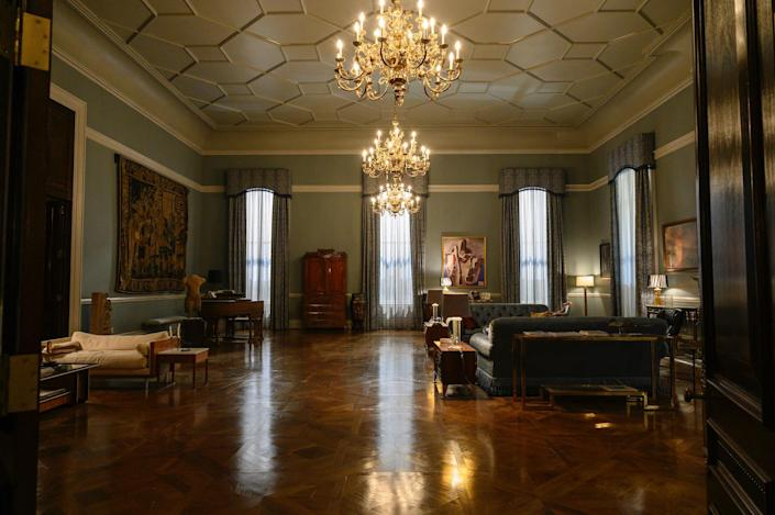 The imposing great room in Franklin's apartment was decorated with two sofas from EJ Victor and surrounded by Russian Neo-Classical case pieces.