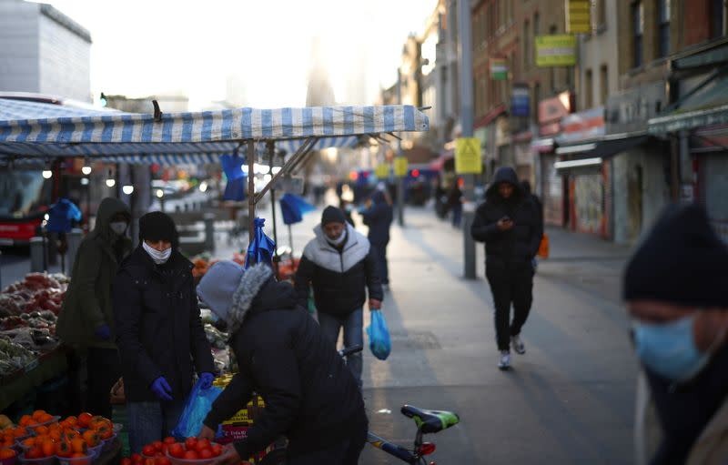 People shop at a market stalls, amid the coronavirus disease (COVID-19) outbreak, in east London