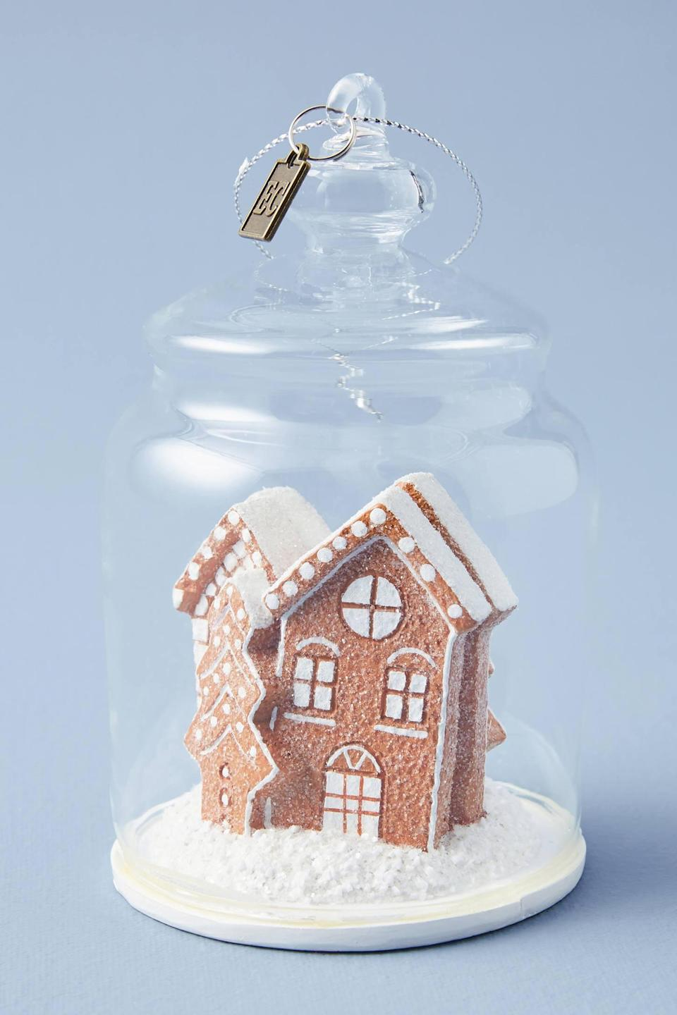 """<p>Trapped in a small glass dome, the <a href=""""https://www.popsugar.com/buy/Gingerbread-Cloche-Ornament-490555?p_name=Gingerbread%20Cloche%20Ornament&retailer=anthropologie.com&pid=490555&price=20&evar1=casa%3Aus&evar9=46615300&evar98=https%3A%2F%2Fwww.popsugar.com%2Fhome%2Fphoto-gallery%2F46615300%2Fimage%2F46615426%2FGingerbread-Cloche-Ornament&list1=shopping%2Canthropologie%2Choliday%2Cchristmas%2Cchristmas%20decorations%2Choliday%20decor%2Chome%20shopping&prop13=mobile&pdata=1"""" rel=""""nofollow noopener"""" class=""""link rapid-noclick-resp"""" target=""""_blank"""" data-ylk=""""slk:Gingerbread Cloche Ornament"""">Gingerbread Cloche Ornament</a> ($20) makes an adorable gift. </p>"""