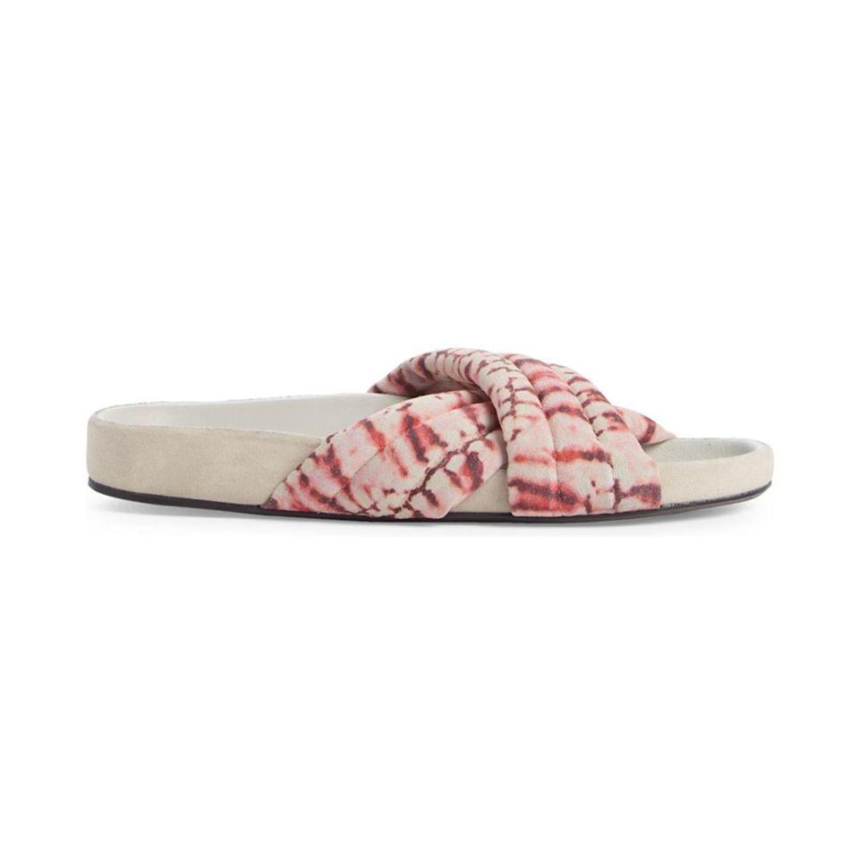 """<p><strong>ISABEL MARANT</strong></p><p>nordstrom.com</p><p><strong>$303.00</strong></p><p><a href=""""https://go.redirectingat.com?id=74968X1596630&url=https%3A%2F%2Fwww.nordstrom.com%2Fs%2Fisabel-marant-holden-tie-dye-slide-sandal-women%2F5770303&sref=https%3A%2F%2Fwww.elle.com%2Ffashion%2Fshopping%2Fg36462948%2Fnordstrom-half-yearly-sale-2021%2F"""" rel=""""nofollow noopener"""" target=""""_blank"""" data-ylk=""""slk:Shop Now"""" class=""""link rapid-noclick-resp"""">Shop Now</a></p><p><strong><del>$505</del> $303 (40% off)</strong></p>"""