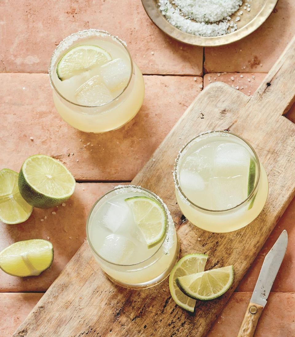 """<p>""""This fruit-forward and crushable long drink is Mexico City's signature cocktail,"""" writes Darlington in <em><a href=""""https://www.amazon.com/Booze-Cruise-Worlds-Essential-Drinks/dp/0762497858/ref=sr_1_1"""" rel=""""nofollow noopener"""" target=""""_blank"""" data-ylk=""""slk:Booze Cruise: A Tour of the World's Most Essential Drinks"""" class=""""link rapid-noclick-resp"""">Booze Cruise: A Tour of the World's Most Essential Drinks</a></em>. """"A well-made Paloma sings with sourness, sweetness, and a touch of bitterness from grapefruit. And it is a taco's best friend. It is often made with grapefruit soda, but it's better with fresh juice. If you like bitter flavor, try an added splash of Aperol or Campari—an addition that helps stimulate the appetite.""""<br></p><p><strong>Ingredients:</strong></p><p>Kosher salt, to rim the glass (optional; sea salt also works)</p><p>2 ounces tequila</p><p>3 ounces fresh grapefruit juice</p><p>1/2 ounce fresh lime juice</p><p>2 teaspoons simple syrup</p><p>2 to 3 ounces club soda</p><p>Lime wheel, for garnish</p><p><strong>Directions:</strong></p><p>Salt the rim of a chilled rocks glass and fill it with ice. Shake tequila, grapefruit juice, lime juice, and simple syrup with ice and strain into prepared glass. Top with soda and garnish with a lime wheel.</p><p><em>Excerpted from BOOZE CRUISE: A Tour of the World's Essential Mixed Drinks by André Darlington. Copyright © 2021. Available from Running Press, an imprint of Hachette Book Group, Inc.</em></p>"""