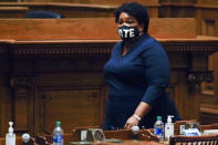 FILE - In this Dec. 14, 2020, file photo, Democrat Stacey Abrams walks on Senate floor before of members of Georgia's Electoral College cast their votes at the state Capitol in Atlanta. In Georgia, voting rights activist Abrams is expected to make a second run for governor in 2022. (AP Photo/John Bazemore, Pool, File)