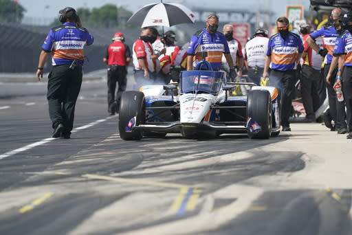 Takuma Sato, of Japan, pulls out of the pits during a practice session for the Indianapolis 500 auto race at Indianapolis Motor Speedway, Friday, Aug. 14, 2020, in Indianapolis. (AP Photo/Darron Cummings)