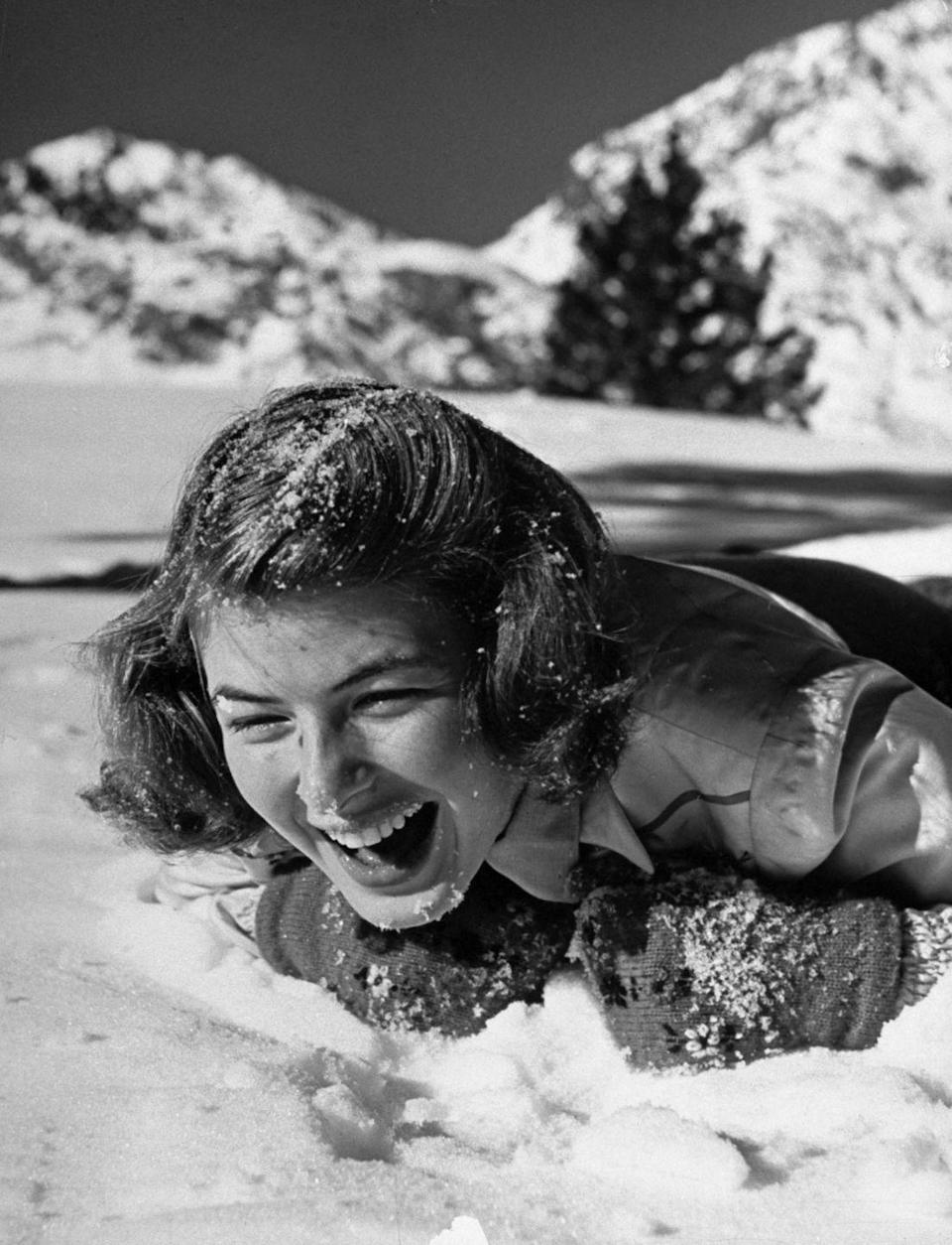 <p>Actress Ingrid Bergman laughing as she lies splashed with snow by an unseen playmate during her ski vacation at June Lake resort, circa 1941.</p>