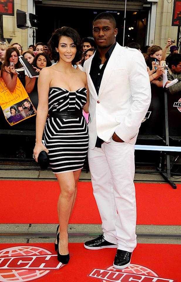 "Kim Kardashian, with main squeeze Reggie Bush, Tweeted before the show that she was channeling Marilyn Monroe with her look. George Pimentel/<a href=""http://www.wireimage.com"" target=""new"">WireImage.com</a> - June 21, 2009"
