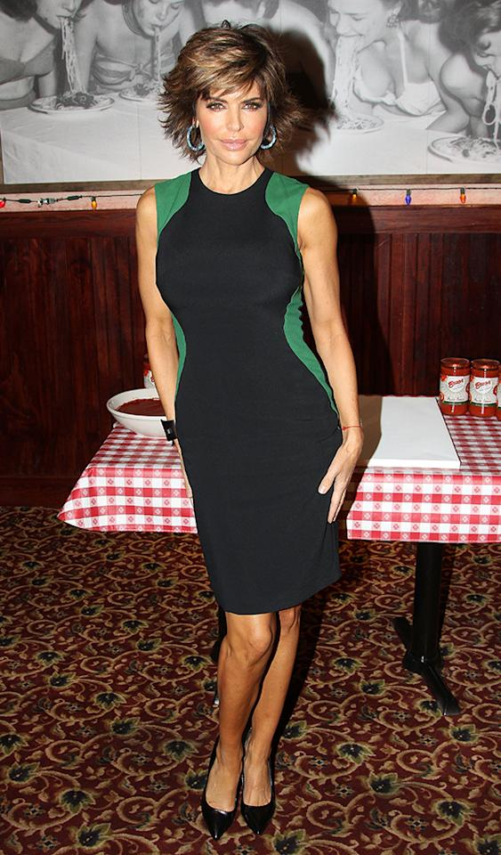"NEW YORK, NY - MAY 13:  Lisa Rinna promotes ""The Celebrity Apprentice"" with a Marinara Sauce Handprint Ceremony at Buca di Beppo on May 13, 2013 in New York City.  (Photo by Bruce Glikas/FilmMagic)"