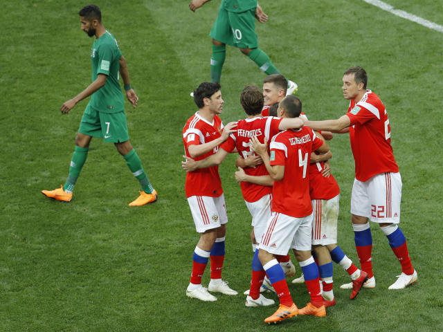 <p>Russian players celebrate their side fifth goal against Saudi Arabia during the opening match of the 2018 soccer World Cup at the Luzhniki stadium in Moscow, Russia, Thursday, June 14, 2018. (AP Photo/Victor Caivano) </p>