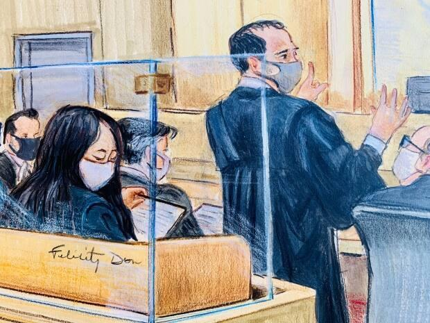Meng sits behind defence lawyer Frank Addario as he argues that new evidence should be included as part of the extradition proceedings against his client.